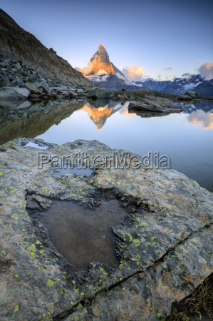 the matterhorn reflected in lake stellisee