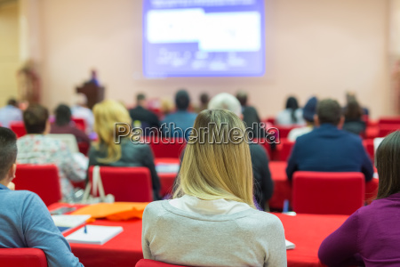 audience in lecture hall on scientific