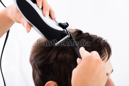 hairdresser cutting persons hair