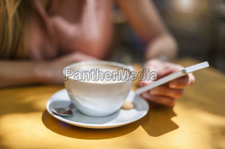 woman sitting in a coffee shop