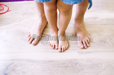 bare legs of father and daughter
