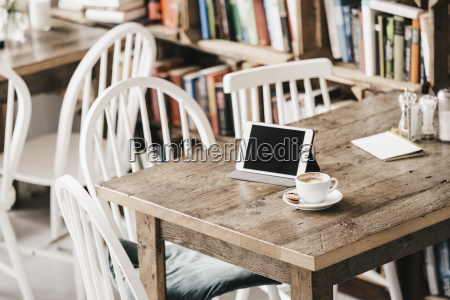 table in a cafe with cup