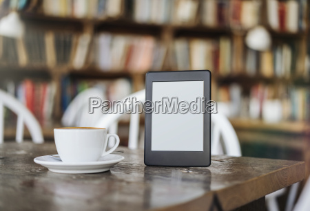 e book and cup of coffee