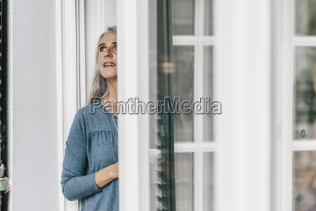 woman standing at open terrace door