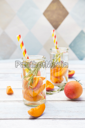 infused water with apricot and rosemary