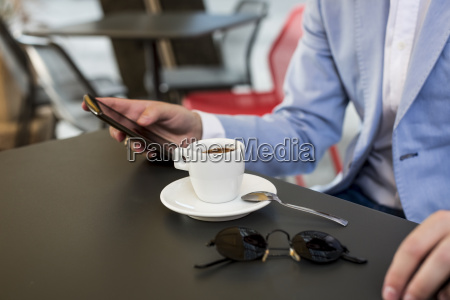 close up of businessman using cell