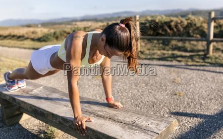 spain asturias sportswoman pushup on bench