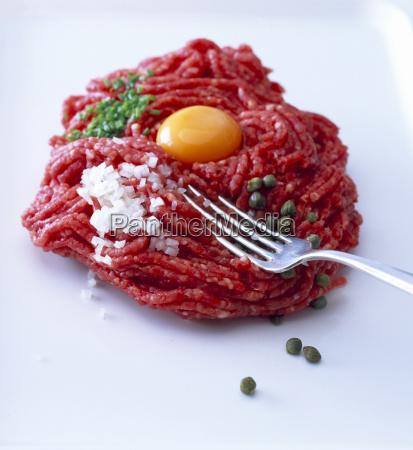 raw steak tatar with egg yolk