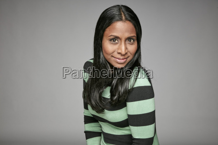 portrait of smiling woman wearing striped