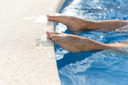 bare feet of man on edge