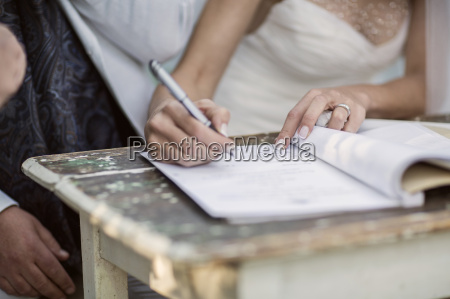 bride signing marriage