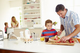 son helping father to prepare family