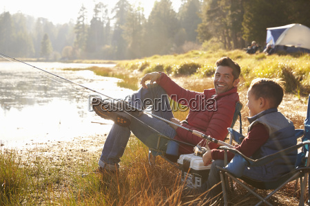 father and son fishing by a