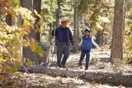 asian father and son hiking together