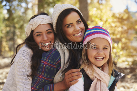 female parents and daughter in a