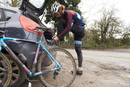 cross country cyclist by his car