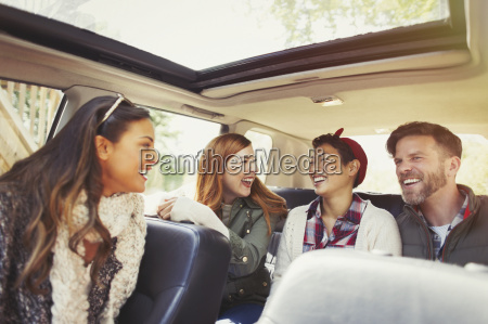 couples riding and laughing in car