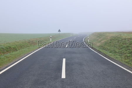 rural road on foggy spring morning