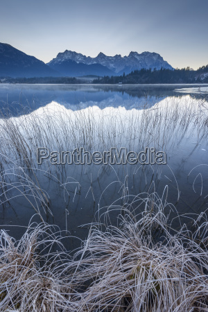 karwendel mountains reflected in lake barmsee