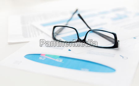 close up of eyeglasses and files