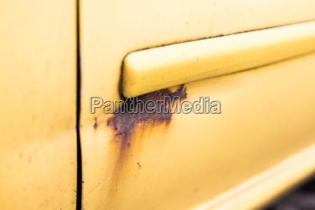 close up of rusty car door