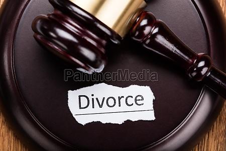 divorce concept on wooden mallet