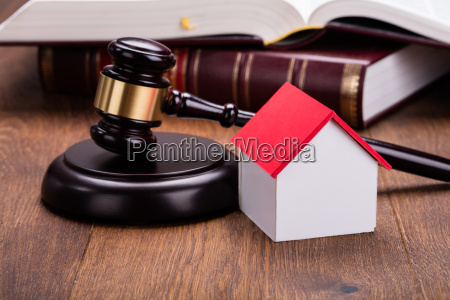 house model with gavel on wooden