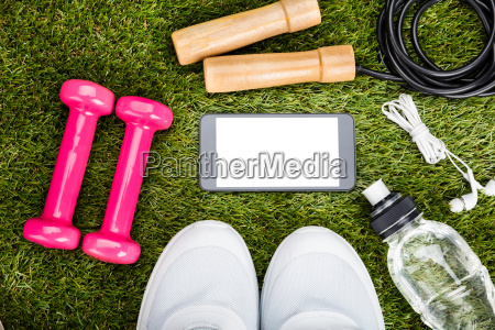 smartphone with exercise equipment on grassy