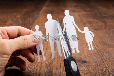 person cutting papercut with scissor
