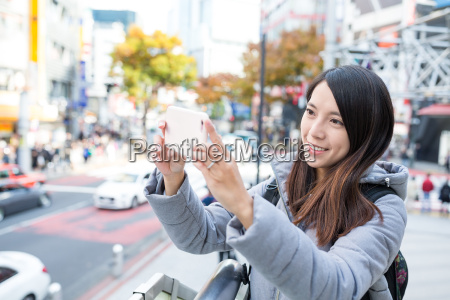 woman capture photo by cellphone