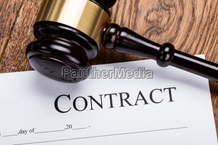 wooden gavel on contract paper