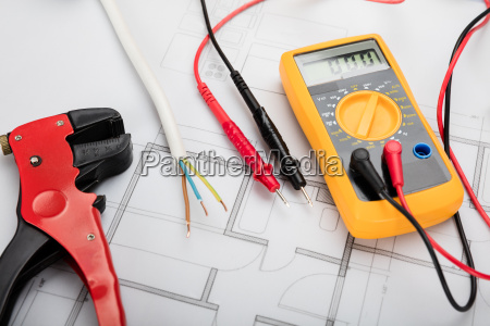 digital multimeter on blueprint