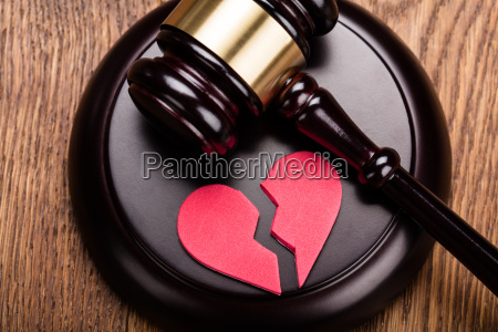 red broken heart on wooden gavel