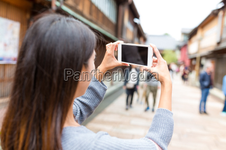 woman taking photo in kanazawa city