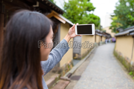 woman using cellphone to taking photo