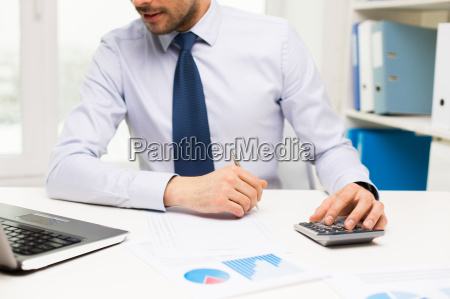 close up of businessman with laptop