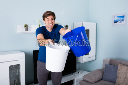 man holding bucket