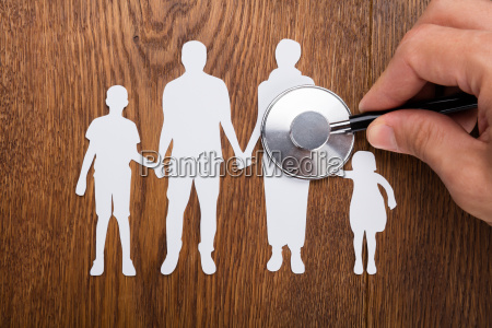 stethoscope on family papercut
