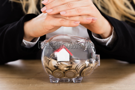 businesswoman protecting her savings in a