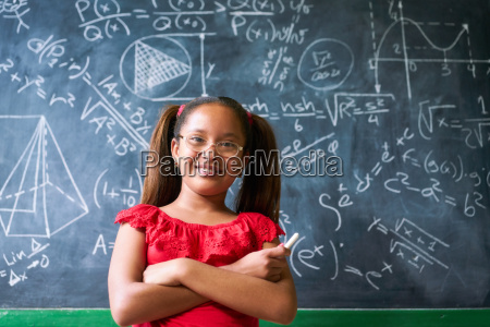 portrait happy girl resolving complex math
