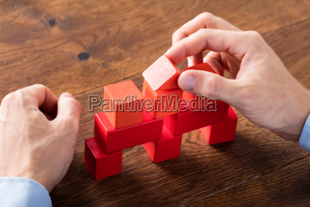 person building blocks