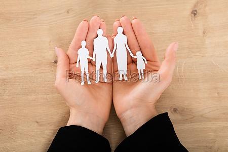 woman hand holding family papercut