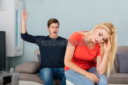 man shouting to his wife at
