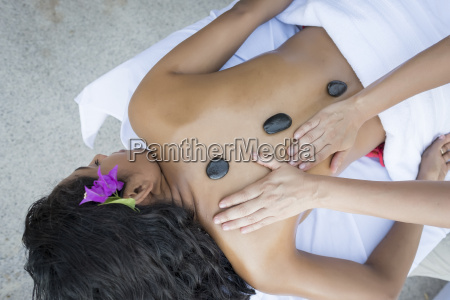 young woman receiving a massage with