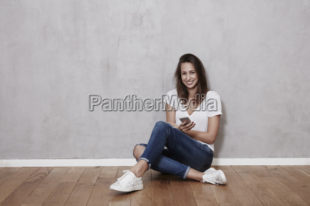 smiling young woman sitting on the