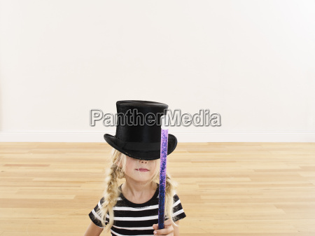 little girl with magic wand wearing