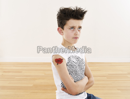 cool boy with tattoo on his
