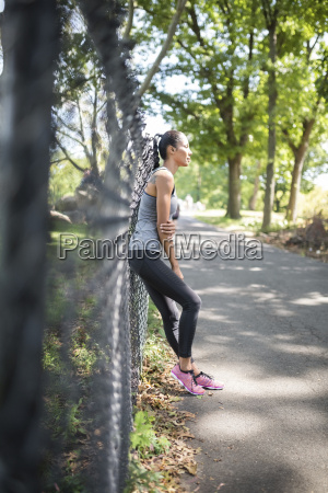 female athlete resting in park