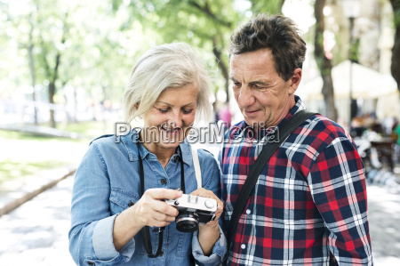 senior couple looking at camera