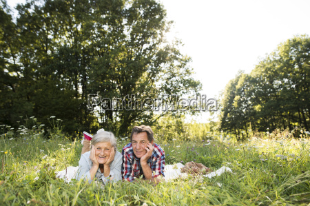 senior couple lying side by side